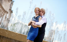 Young loving couple by the fountain Royalty Free Stock Image