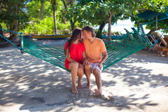 Young loving couple in a hammock at exotic resort Stock Images