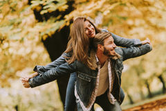Young loving couple having fun in the autumn park Royalty Free Stock Photos