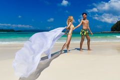Young loving couple having fun on a tropical beach Stock Photography