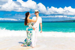 Young loving couple having fun in the tropical beach Stock Images