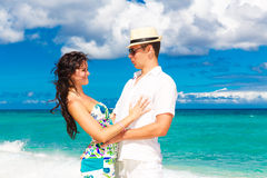 Young loving couple having fun in the tropical beach Stock Photography