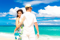 Young loving couple having fun in the tropical beach Stock Image
