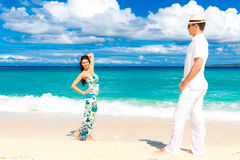 Young loving couple having fun in the tropical beach Royalty Free Stock Photos