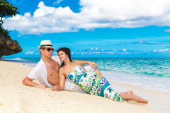 Young loving couple having fun in the tropical beach Royalty Free Stock Image
