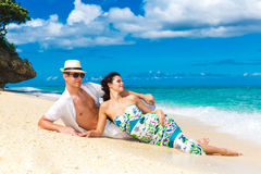 Young loving couple having fun in the tropical beach Stock Photos