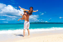 Young loving couple having fun in the tropical beach Royalty Free Stock Photography