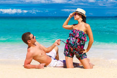 Young loving couple having fun in the tropical beach Royalty Free Stock Images
