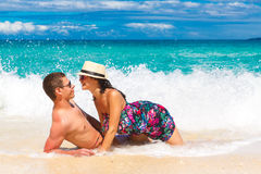 Young loving couple having fun in the tropical beach Royalty Free Stock Photo