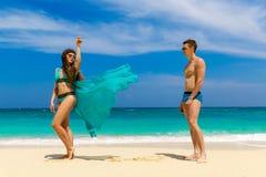 Young loving couple having fun on tropical beach. Summer vacatio Royalty Free Stock Photos