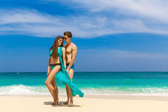 Young loving couple having fun on tropical beach. Summer vacatio Stock Image