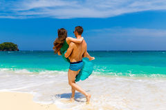 Young loving couple having fun on tropical beach. Summer vacatio Royalty Free Stock Photo