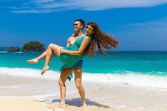 Young loving couple having fun on tropical beach. Summer vacatio Stock Photo