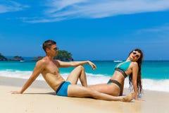 Young loving couple having fun on tropical beach. Summer vacatio Stock Photography