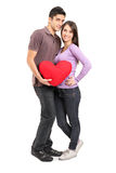 Young loving couple holding a pillow Royalty Free Stock Photo