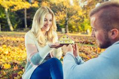 Young loving couple holding small model house. stock images