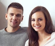 Young loving couple. Home, family concept. Man and woman relations. Young loving couple at home. Man and women embracing royalty free stock photography