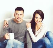 Young loving couple. Home, family concept. Man and woman relations. Young loving couple at home. Man and women embracing stock image