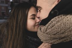 Adolescents in Love Outside the Room. Life Style. Winter Concept. Young Loving Couple Hugging Winter Outdoors. Teen stock photo