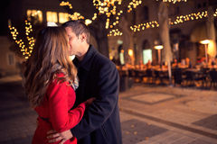 Young loving couple kissing in the city center Royalty Free Stock Photo