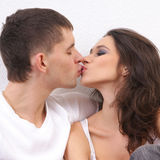A young and loving couple kissing each other Royalty Free Stock Images