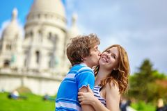 Young loving couple kissing near the Sacre-Coeur Stock Photography