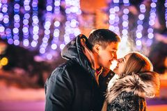 Young loving couple kissing in a winter city. Stock Photography