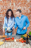 Young Loving Couple in the Kitchen Stock Photo