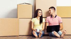 Young loving couple moving to a new house. Home and family concept. Stock Image
