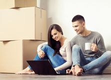 Young loving couple moving to a new house. Home and family concept. Stock Photos