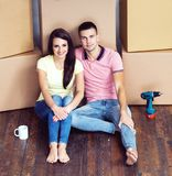 Young loving couple moving to a new house. Home and family concept. Royalty Free Stock Image