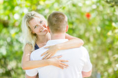Young loving couple on natural background Stock Image