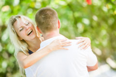 Young loving couple on natural background Stock Photos