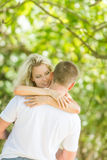 Young loving couple on natural background Stock Images