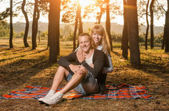 Young loving couple in the Park sitting on a blanket Stock Photo