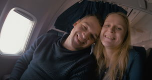 Young loving couple in the plane stock video