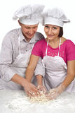 Young loving couple playing with dough Royalty Free Stock Photo