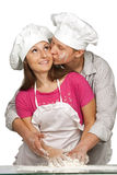 Young loving couple playing with dough Royalty Free Stock Photography