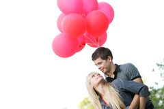 Young loving couple with red balloons Stock Photos