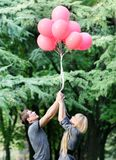 Young loving couple with red balloons Royalty Free Stock Photo