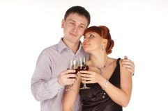 Young loving couple with red wine glasses in hands Royalty Free Stock Photos
