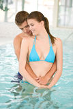 Young loving couple relax in swimming pool. Young loving couple relax in swimming in luxury hotel Stock Photography