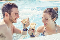 Young loving couple relaxes and drink wine Royalty Free Stock Photo