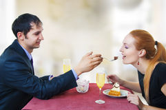 Young loving couple in restaurant. Royalty Free Stock Images