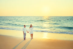 Young loving couple on the sea beach. Stock Photo
