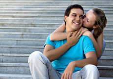 Young loving couple sitting on stairs Stock Photo