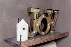 Small wooden house new home concept.Text Message wording of the word JOY in my new house. Let dreams come true.card Stock Photo