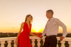 Young loving couple standing next to the stone gazebo with the s Stock Image