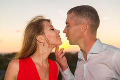 Young loving couple standing next to the stone gazebo with the s Royalty Free Stock Image