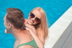 Young loving couple on vacation near water Stock Images